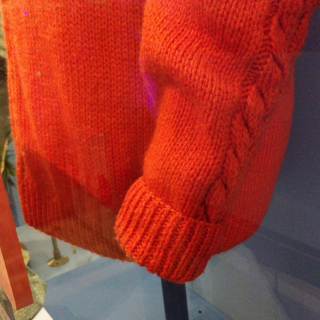 very zoomed in picture of Mr. Rogers's sweater sleeve and cuff