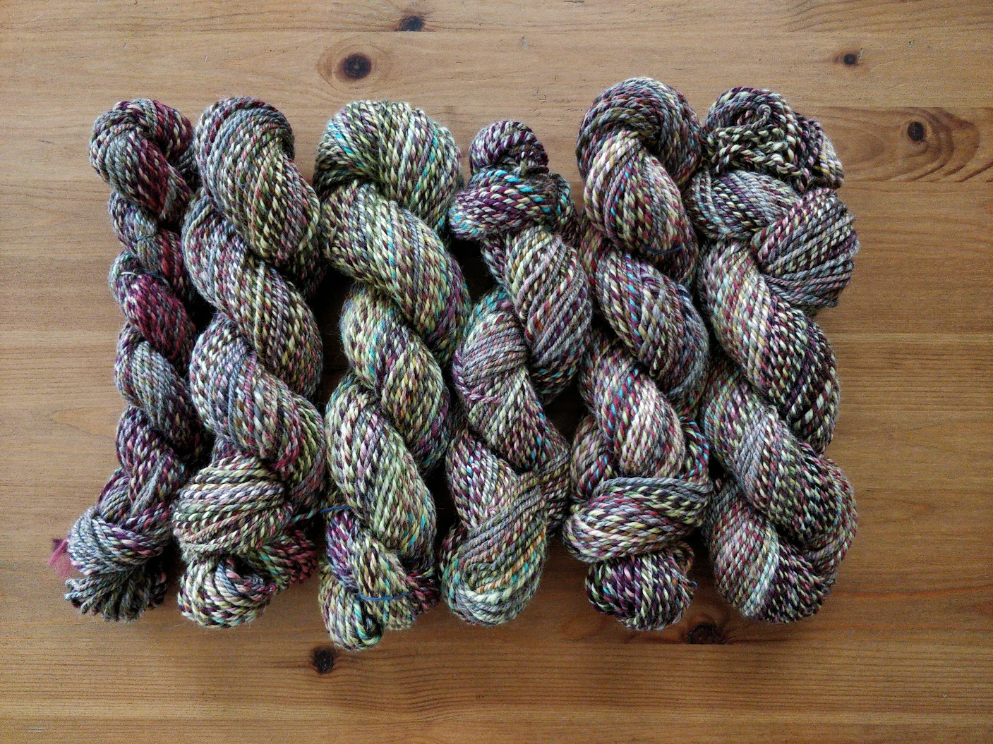 Several multi-coloured skeins of handspun yarn