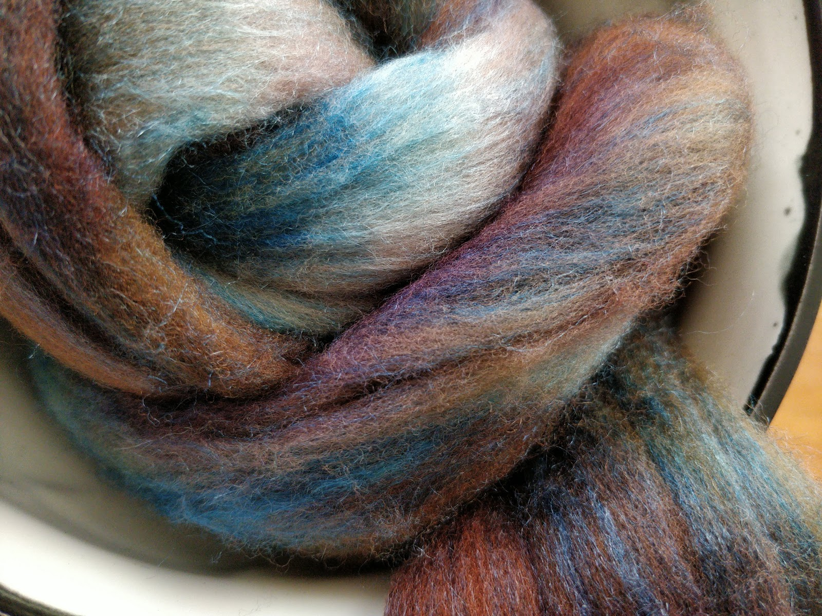 Blue and brown wool-silk blend. The silk is very shiny.