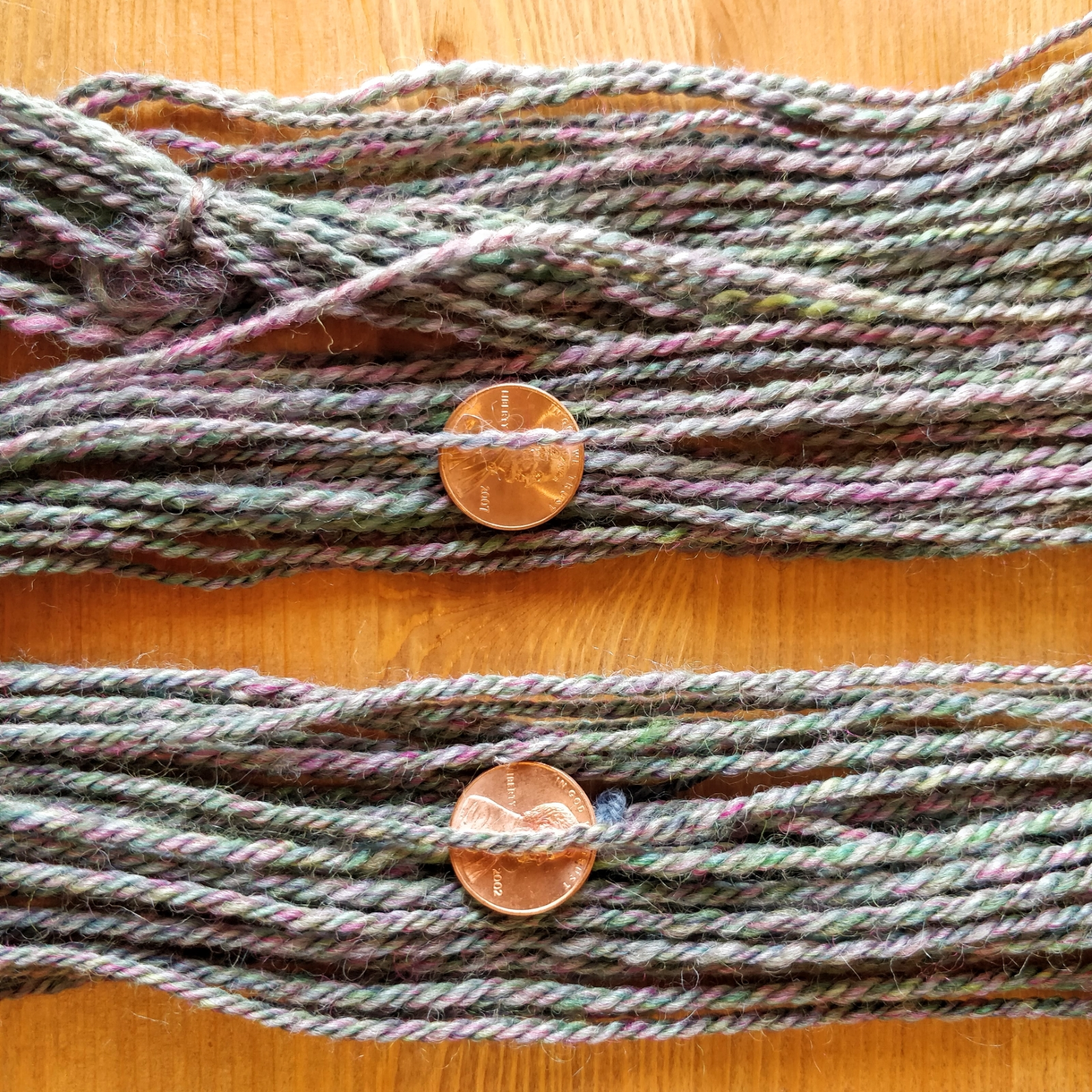 Samples of two-ply and three-ply yarn, spun from the same singles.