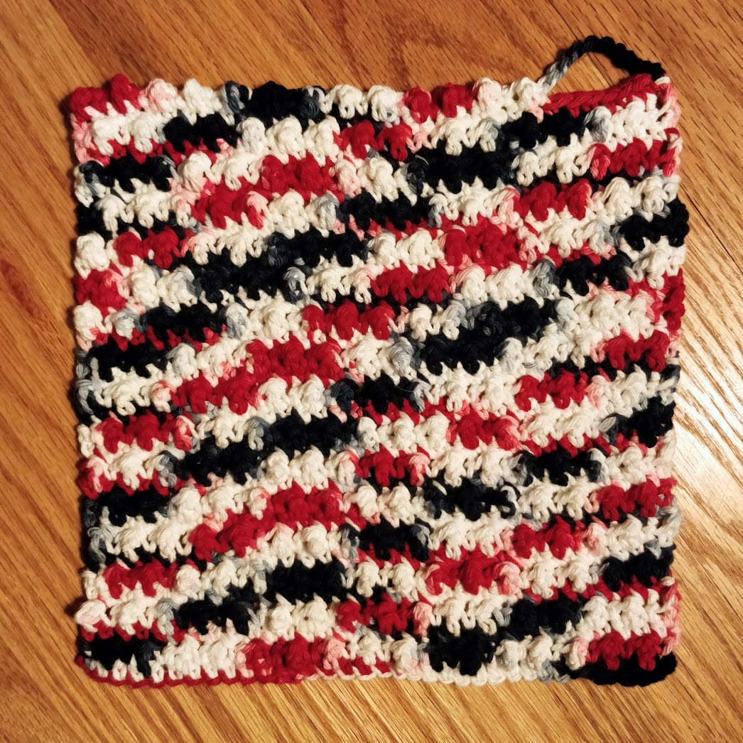 A red, white, and blue washcloth.