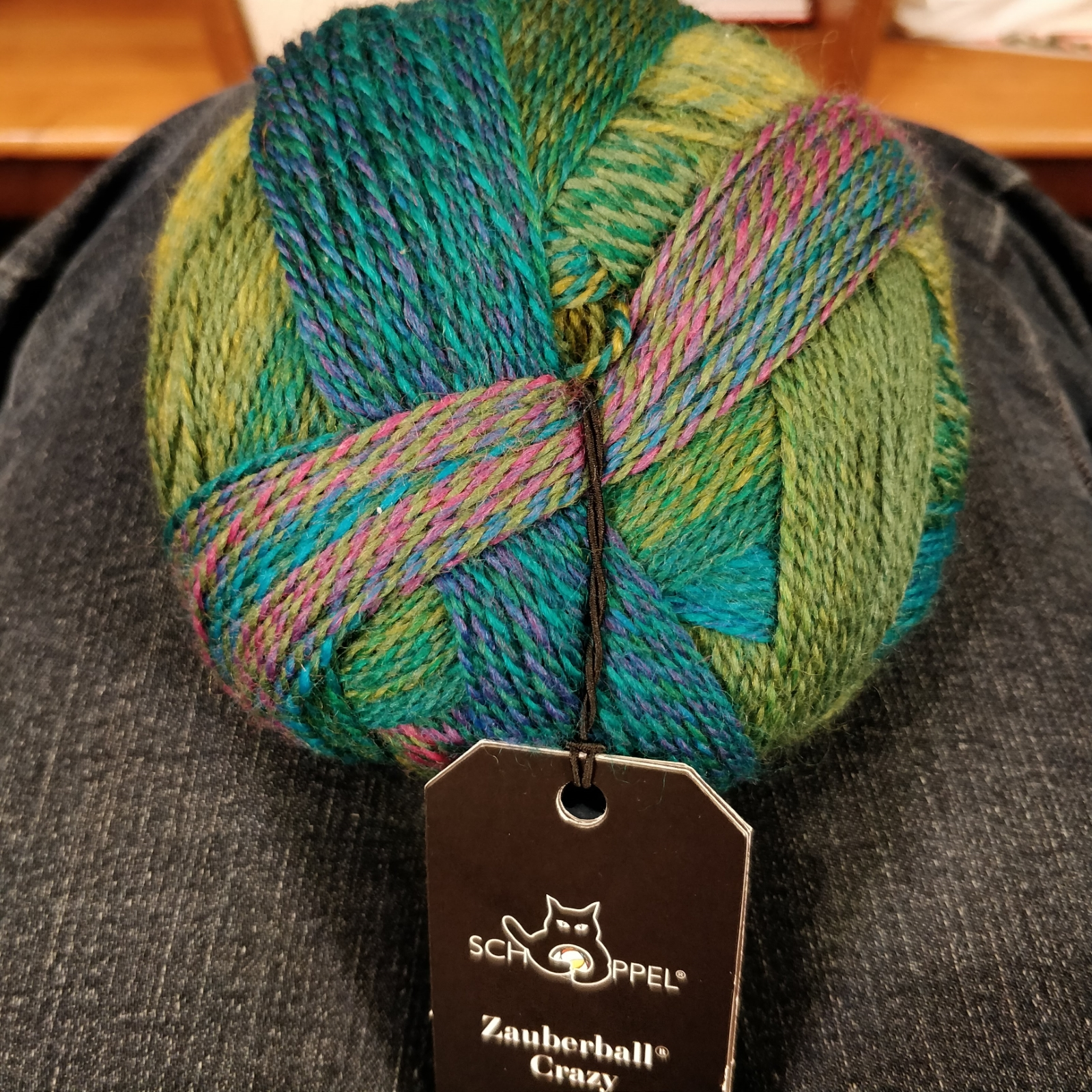 "A ball of ""Zauberball Crazy"" in greens and teals."